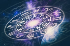Astrological zodiac signs inside of horoscope circle on universe background.