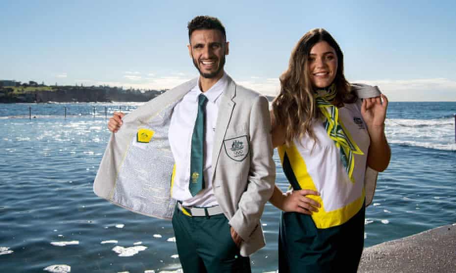 Australian taekwondo athlete Safwan Khalil (left) and softballer Tarni Stepto pose at the Australian Olympic team opening ceremony uniform unveiling at Wylie's Baths in Sydney