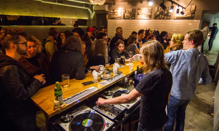 Khroniki, bar in St Petersburg, Russia. DJs are playing to a busy room.