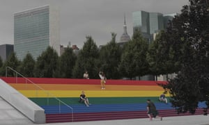 The United Nations headquarters, left, looms in the background as visitors take pix in celebration of WorldPride, the celebration that will converge on New York on the final weekend of this month, coinciding with the 50th anniversary of the uprising at the city's Stonewall Inn that kick-started the modern gay rights movement.