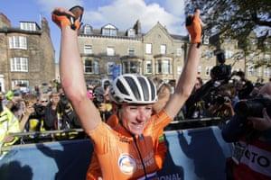 Annemiek van Vleuten celebrates after winning the women elite race.