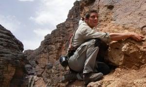 Bear Grylls  climbing cliff