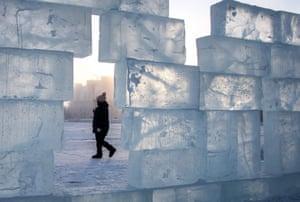 Siberia, Russia: A woman walks behind an ice wall