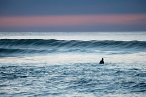 A surfer waits for a wave