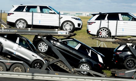 New Land Rover cars carried on a car transporter lorry