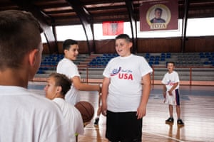 Children play basketball during the friendly tournament on 4 July