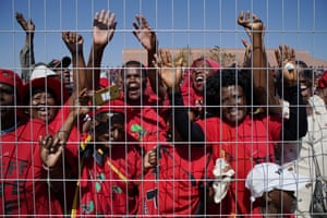 Johannesburg, South Africa. Supporters of Julius Malema, the leader of the Economic Freedom Fighters, cheer as he arrives at a May day rally in Alexandra
