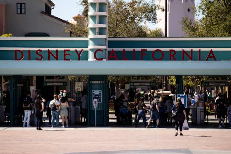 Visitors arrive at Disneyland California for the reopening of the amusement park in Anaheim.