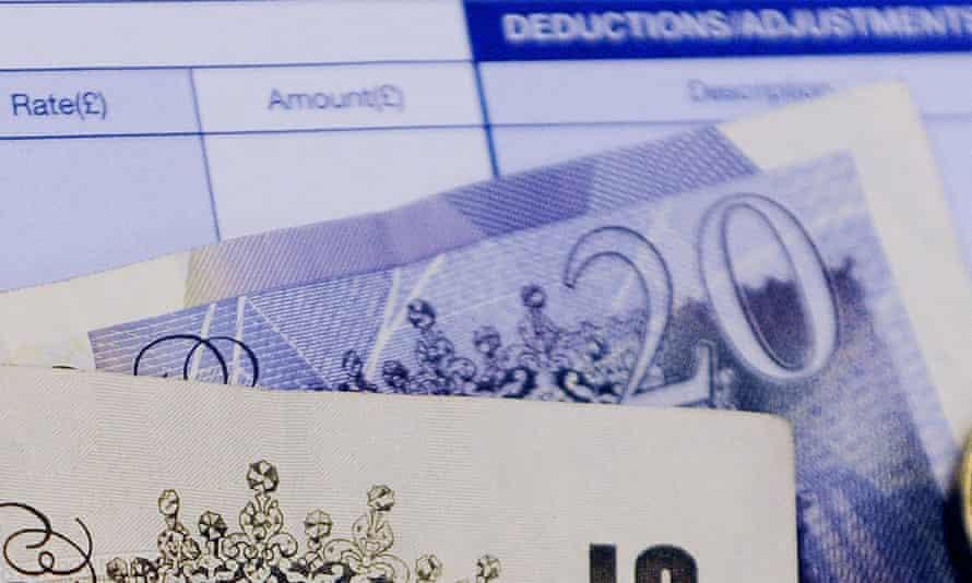 File photo of money on a wage slip