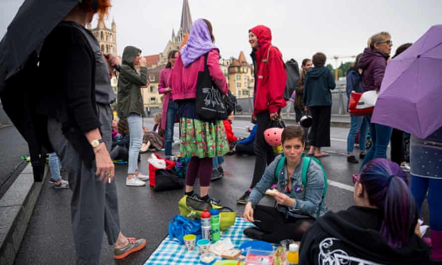 Women hold a protest picnic in Lausanne.