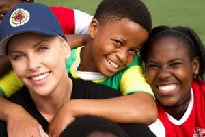 Charlize Theron with young participants of one of her project's grantees, WhizzKids United,