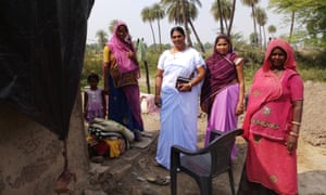 Phoolbati with health workers Lata Nayar and Vimla Gochar, and a villager.