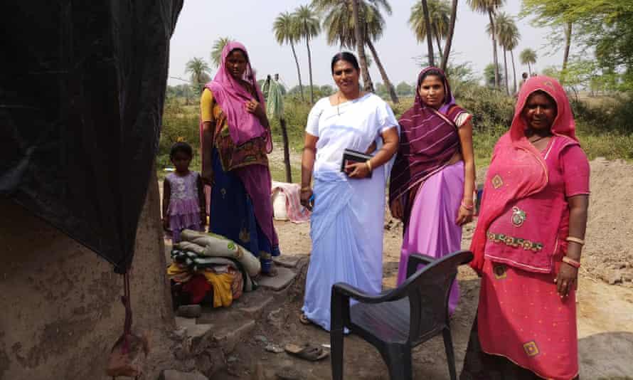 Phoolbati with health workers Lata Nayar and Vimla Gochar, and a villager.