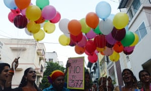 Indians with balloons and placards.
