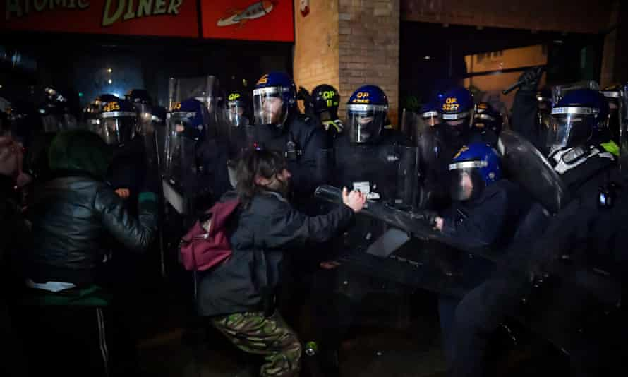Police clear demonstrators at Friday's protest in Bristol.