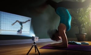 A lady practices yoga using the mobile projector