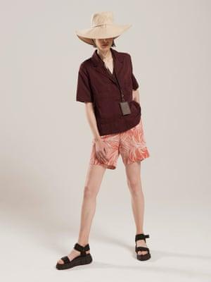 model wears  shorts, £39, monsoon.co.uk. Top, £59, cosstores.com. Lanyard, £60, coach.com. Sandals, £45, office.co.uk. Hat, £17.99, zara.com.