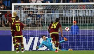 Woodman saves the penalty from Penaranda.