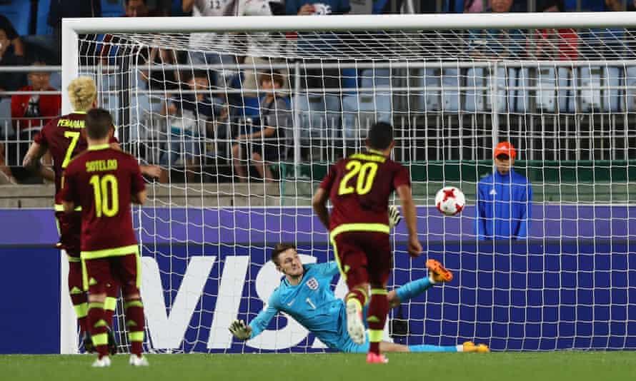 England's Freddie Woodman saves a penalty from Adalberto Peñaranda of Venezuela in the Under-20 World Cup final.