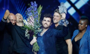 Duncan Laurence, representing the Netherlands, lifts the glass microphone trophy after being announced the winner.