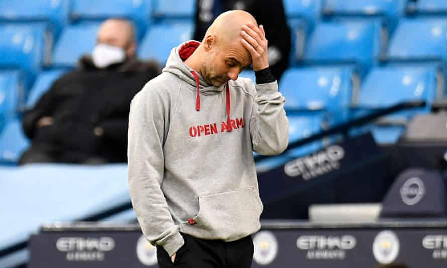 Pep Guardiola cuts an unhappy figure during Manchester City's 2-0 defeat by Manchester United