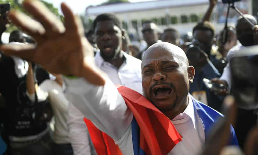 A man reaches out in grief at the funeral of Haiti's President Jovenel Moïse on Friday.