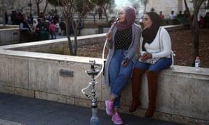 Girls in Amman smoke waterpipes