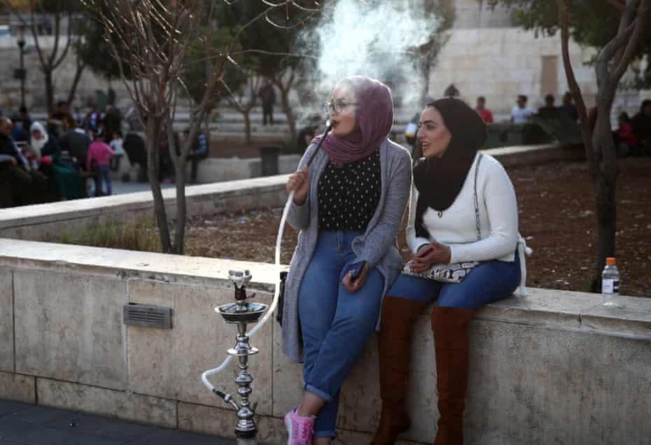 People smoking hookah in Hashemite Plaza, Amman, Jordan.