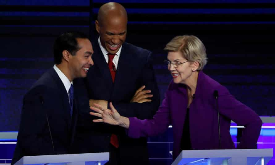 Candidates chat during a break at the first US 2020 presidential election Democratic candidates debate in Miami, Florida