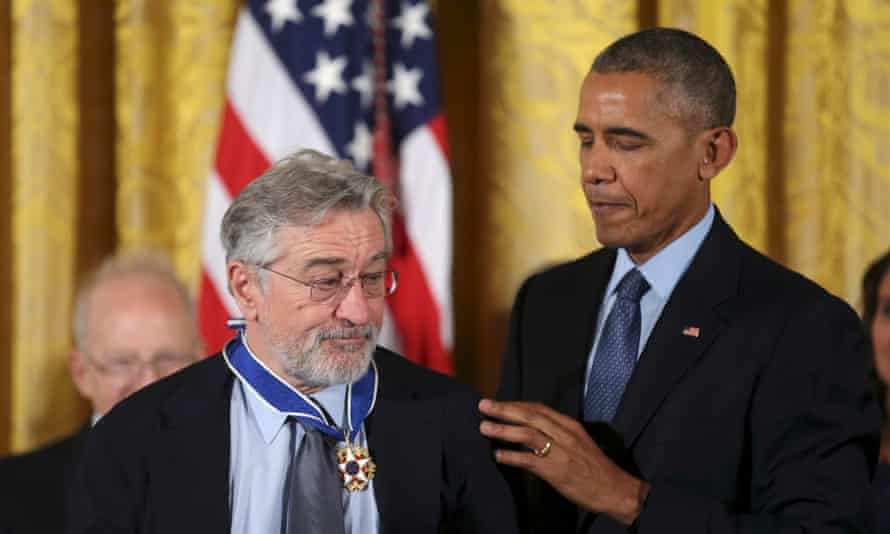 Barack Obama in 2016 presenting the Presidential Medal of Freedom to Robert De Niro, one of the stars of The Irishman.