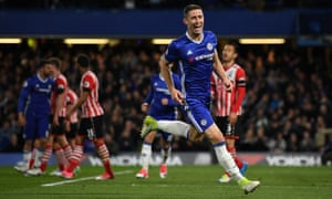 Gary Cahill celebrates after restoring Chelsea's lead against Southampton on Tuesday night with his vital goal on the stroke of half-time.
