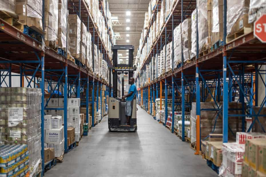Arric Davis, an employee at the Houston Food Bank drives a fork lift through the dry products warehouse Friday September 28, 2018.