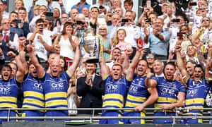 Prince Harry and Tony Adams look on as Warrington Wolves lift the Challenge Cup in 2019.