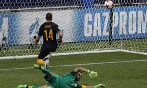 Australia's James Troisi, top, scores past Chile goalkeeper Claudio Andres Bravo