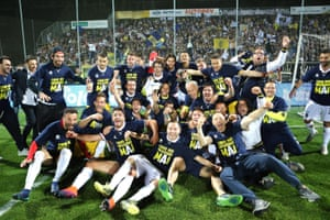 Parma players celebrate after securing their third straight promotion.