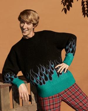 Model wears green blue black patterned jumper, £45, weekday.com. Trousers, £24.99, hm.com.