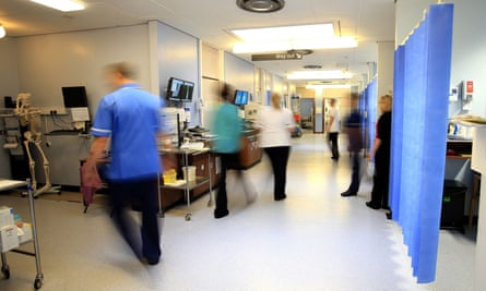 A busy hospital ward. Doctors have described corridors overflowing with patients and used social media in a bid to find extra staff to cope with demand.