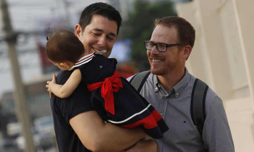 Gordon Lake and Manuel Santos, with baby Carmen