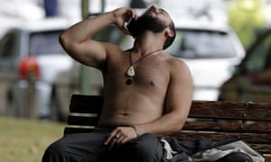 A man speaks on a phone after the shootings in central Christchurch
