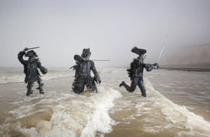 Three sculptures of pirates from Pirates of the Caribbean: Salazar's Revenge emerge from the sea near the cliffs of Birling Gap and the Seven Sisters to celebrate the release of the film