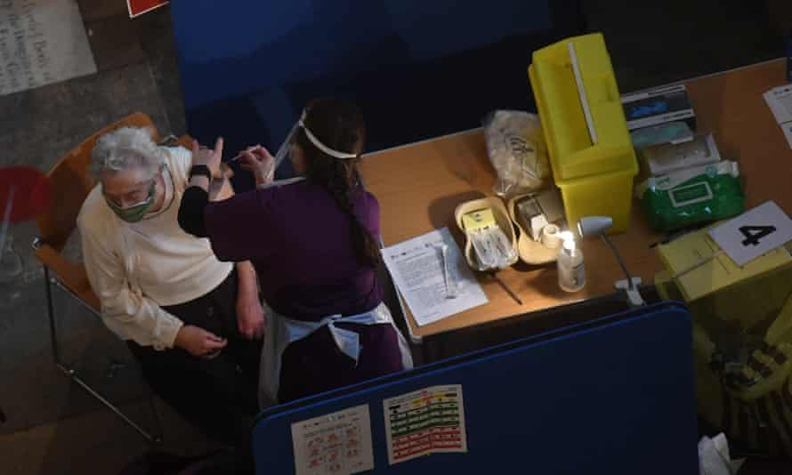 A nurse administers the Pfizer/BioNTech vaccine in Salisbury Cathedral.