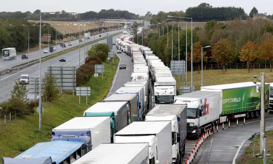 Lorries queue on the M20 for the Eurotunnel in Folkestone, Kent, as a 27-acre site near Ashford is developed into a post-Brexit lorry park, 25 September 2020.