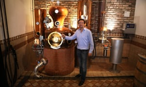 Rainer Engel of the Altstadthof brewery with his whisky still.