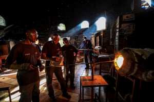 A team of glassblowers create objects  from recycled glass scrap materials