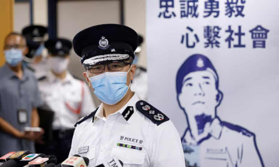 Police chief Raymond Siu speaks in front of a banner with the police force's motto 'Serving Hong Kong with Honour, Duty and Loyalty'