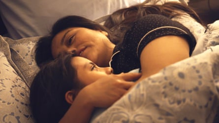 Vilma and her daughter Yeisvi reunited and cuddling in their bed in Torn Apart