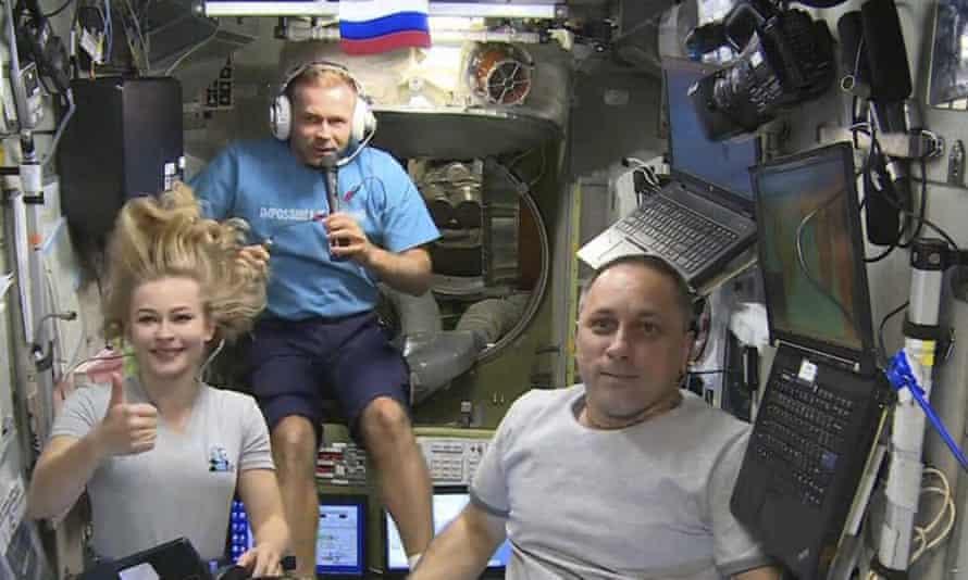 Yulia Peresild, left, film director Klim Shipenko, center, and cosmonaut Anton Shkaplerov speak aboard the ISS.
