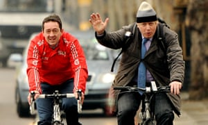 Mayor of London Boris Johnson and former professional cyclist Chris Boardman ride together in London in 2013.