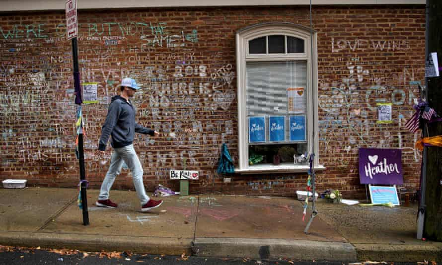 A man walks past a memorial to Heather Heyer and the victims of the car attack in Charlottesville, Virginia on 26 November.
