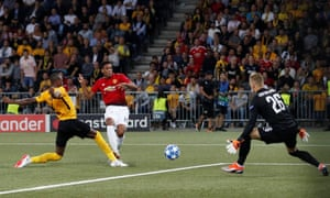 Manchester United's Anthony Martial scores their third goal past Young Boys' keeper David von Ballmoos.